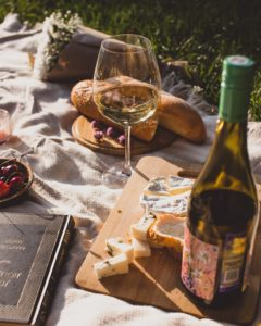 Picnic scene with wine and cheese