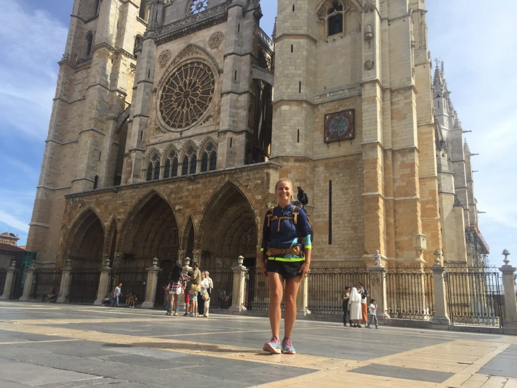 Walking the Camino alone, Jamie in front a cathedral