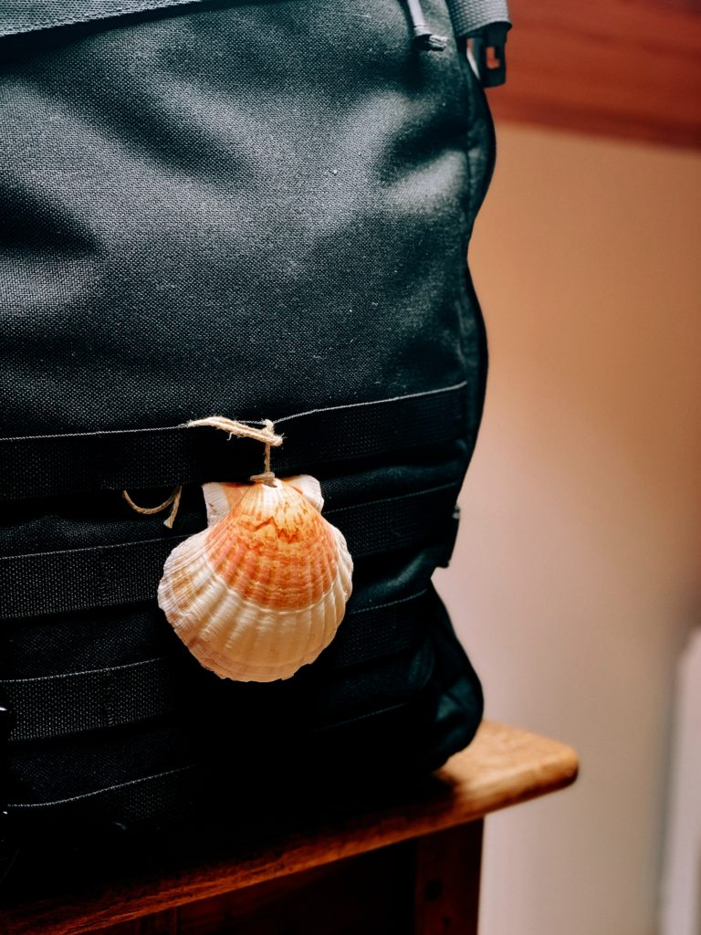 A backpack and shell, the symbol of the Camino