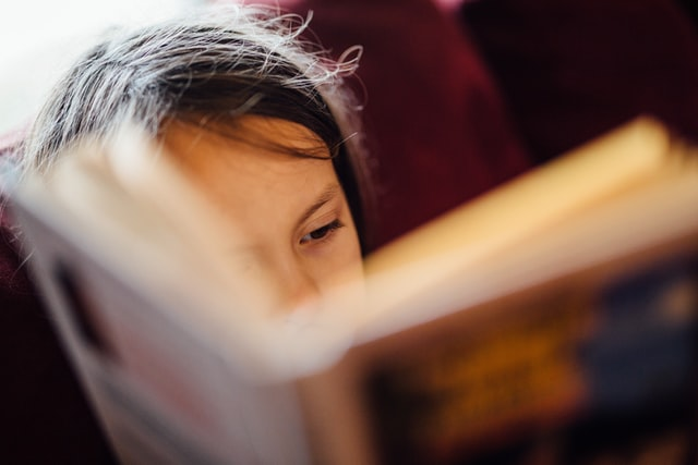 Educate youth, young girl reading